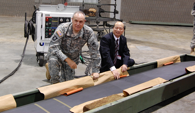 At the 2007 Army Aviation Association of America (AAAA) Convention, Shek Hong reviewed the Hontek-coated Black Hawk blade on display with Major General James Pillsbury.  General Pillsbury was instrumental in providing funding and support for the fielding of the coated blades.