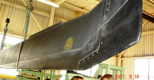 """This photo shows the as-received condition of the blade on Black Hawk #834 when it was inspected at Sikorsky on 9-18-2007.  The gray area at the outboard tip was just a minor topcoat damage. The gray basecoat was still intact. The multiple repairs on the blades over the one year period did not cause excessive weight build-up. The unit reported no track and balance issues with the repairs.  The Army concluded that Hontek-coated blades have the potential to offer """"unlimited blade life"""" against erosion damages if properly maintained with Hontek repair kits."""