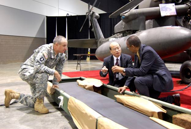 At the 2007 AAAA Convention, Shek Hong explained the benefits of Hontek-coated rotor blades to Major General Pillsbury and the Honorable Claude Bolton, Jr. - Assistant Secretary of the Army for Acquisition, Logistics and Technology (right).