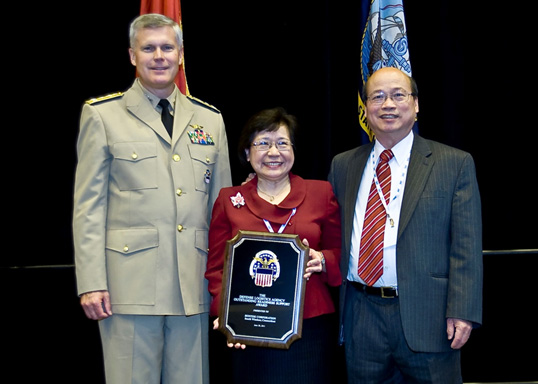 Shek and Joanne Hong received the 2011 DLA Award from Vice Admiral Thompson, DLA Director, in recognition of Hontek's successes in providing repair training and repair kits to keep the helicopters flying without expensive blade replacements.